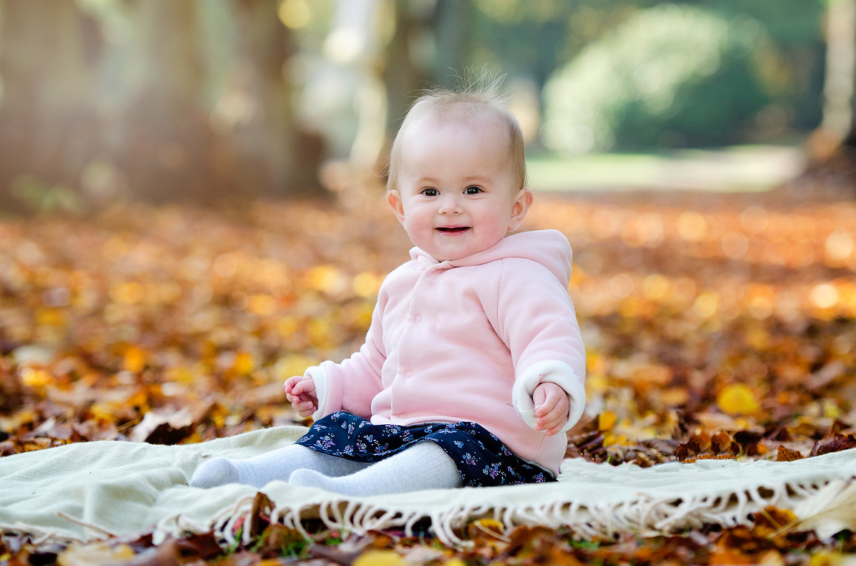 Baby in the autumn leaves