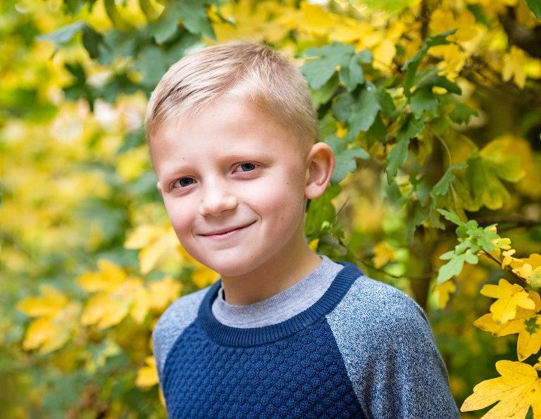 Boy enjoying an autumn photo shoot