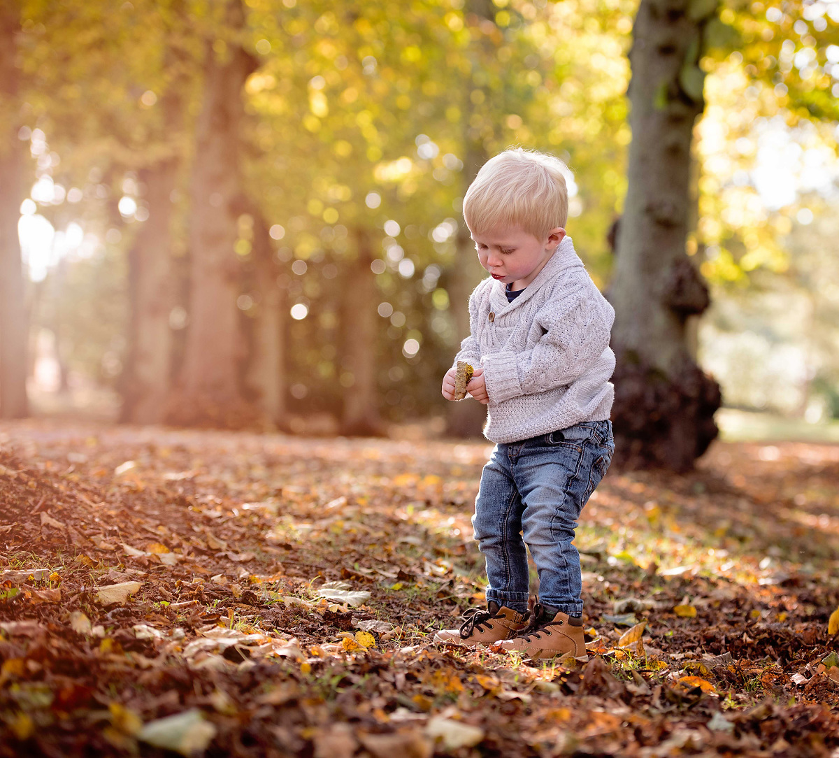 Boy in the woods enjoying an autumn photo shoot