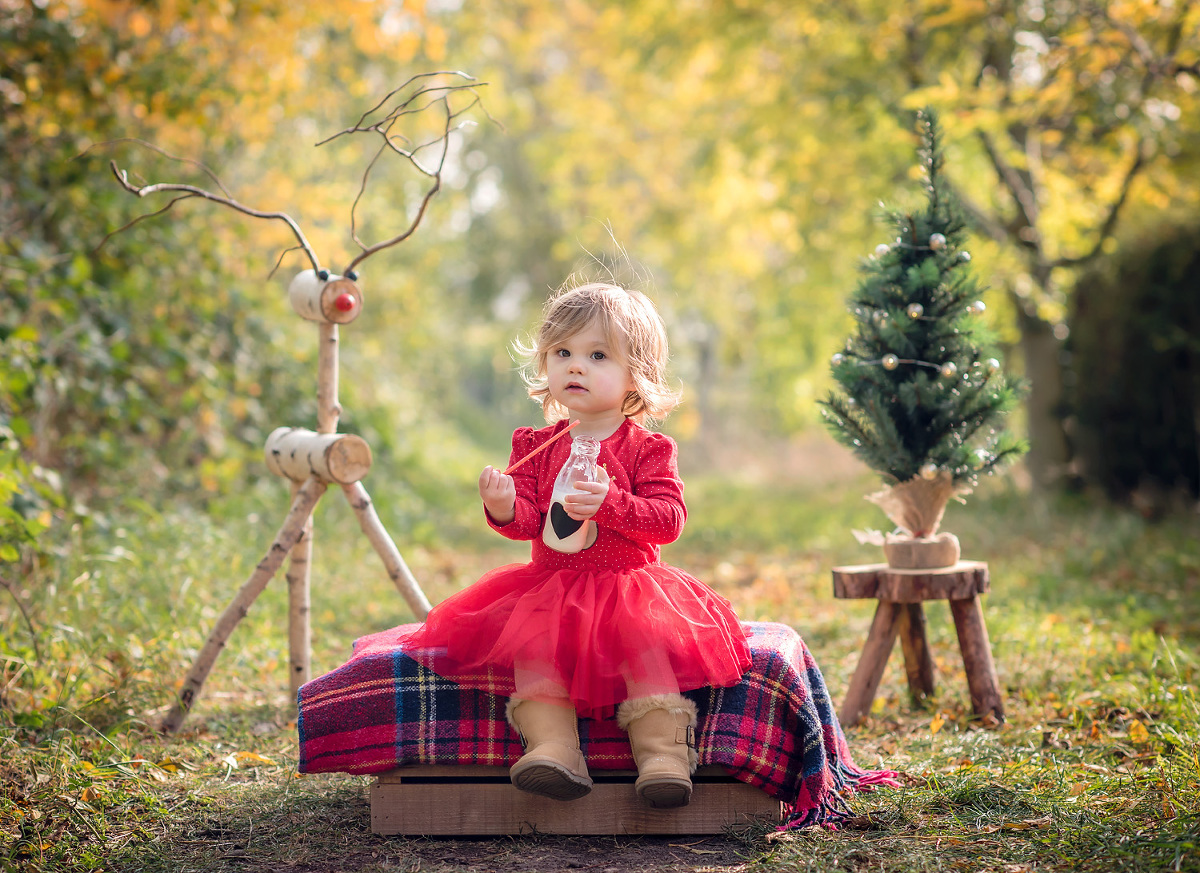 Girl enjoying a Christmas photo shoot