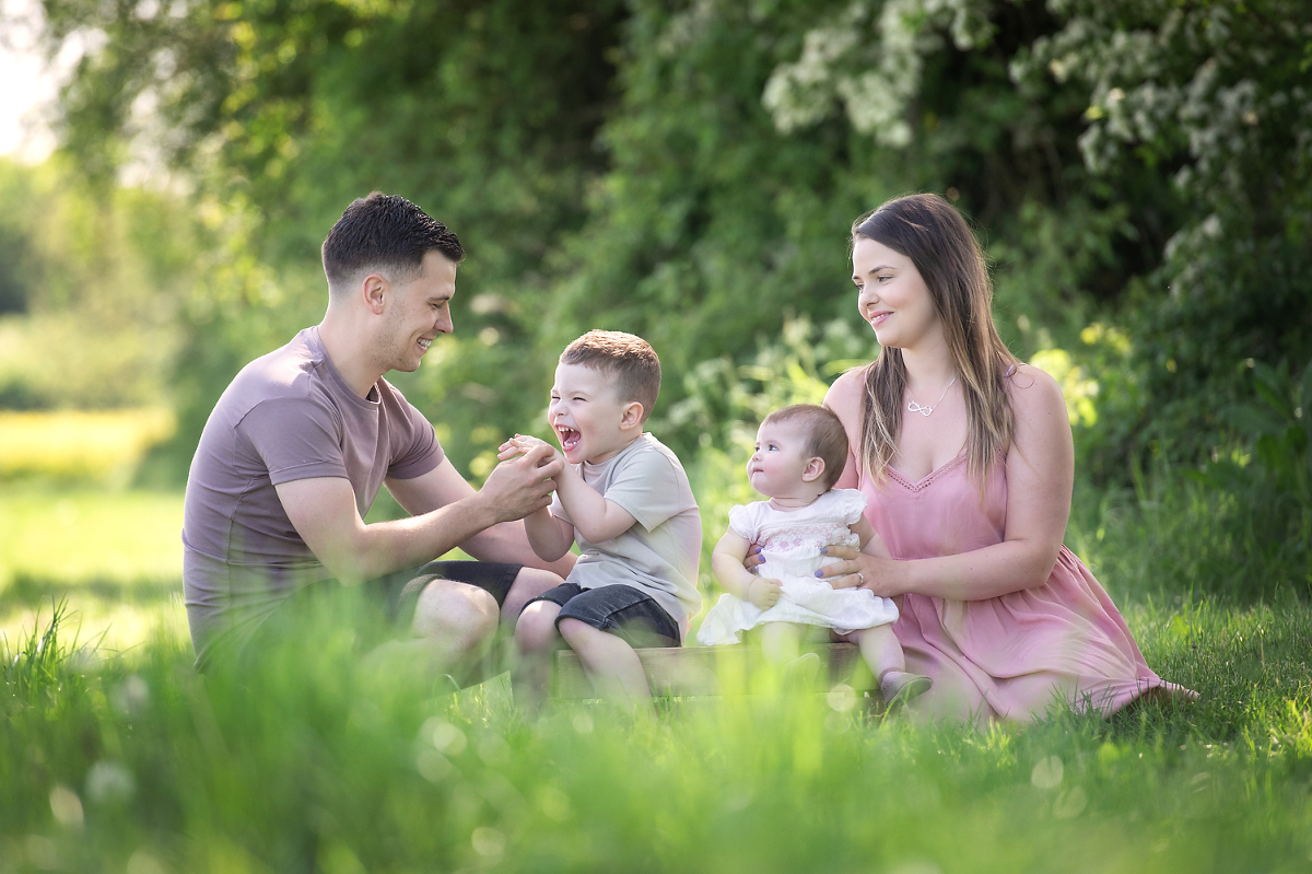 Family enjoying a summer photo shoot