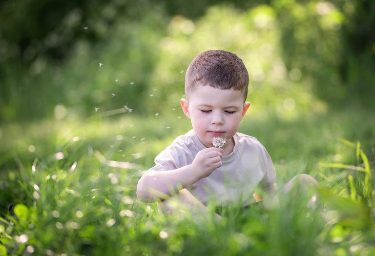 Little boy playing in field