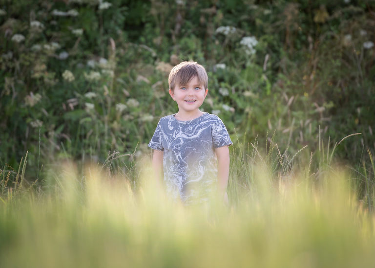 Boy playing in the fields